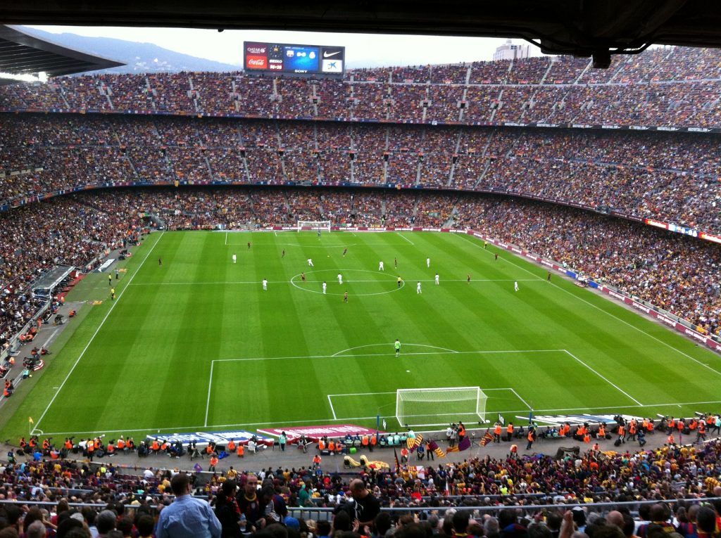 A football stadium with spectators and players in the frame in Barcelona Spain
