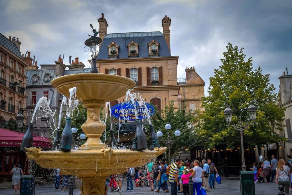 Ratatouille ride at Disneyland Paris with a fountain and many visitors