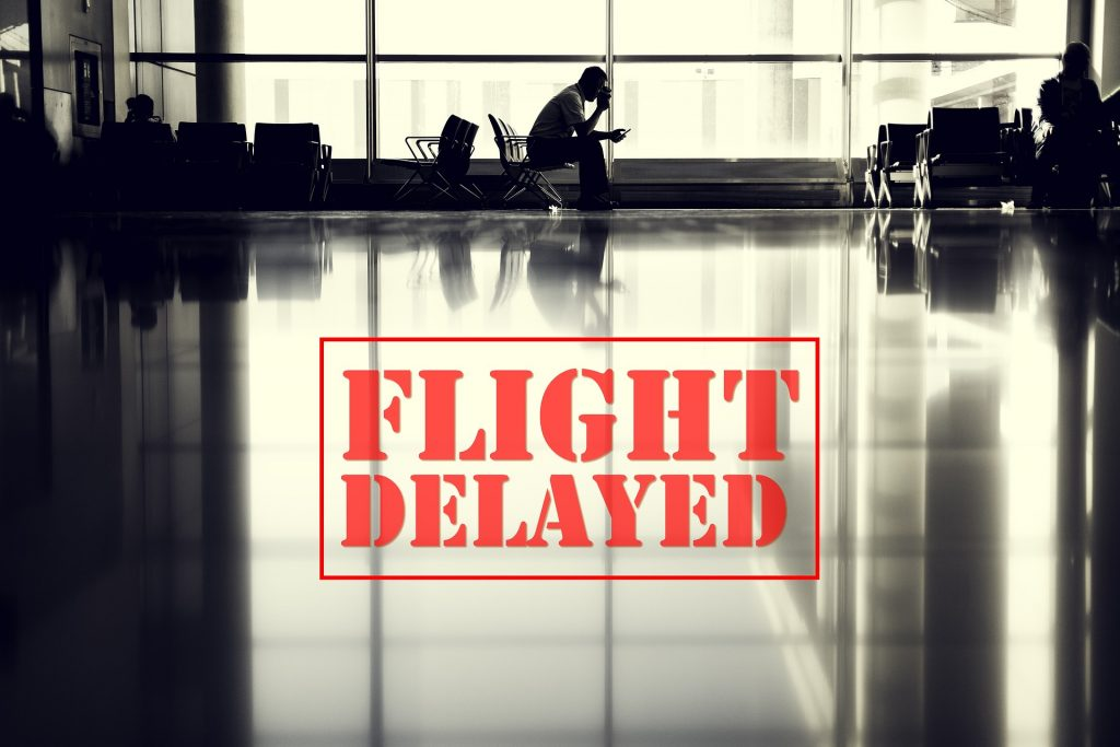 An airport with passenger sitting due to delayed flight